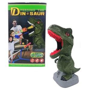 Imagen de Pistola lanza pelotas, dinosaurio con tanteador y sonido, 3AA y lanza cohetes de goma EVA de pie, en caja